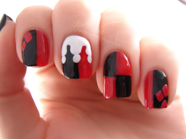 The red and black geometric nail art