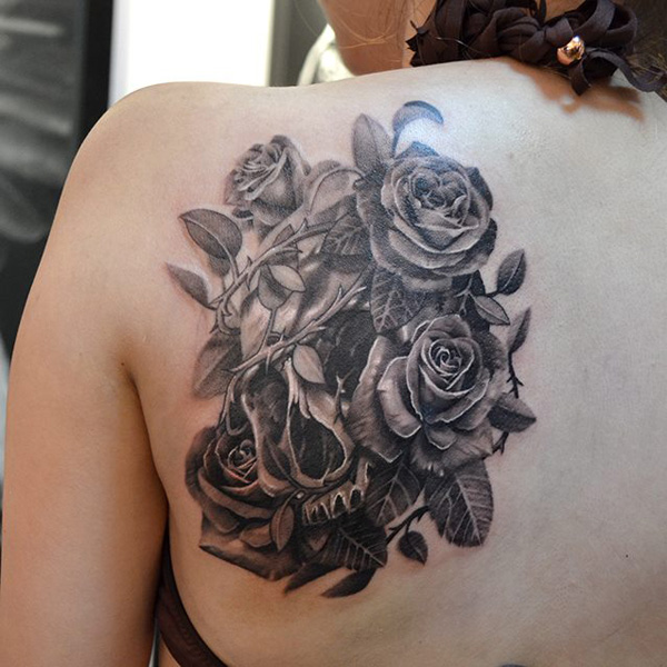 Black and white tattoo on back