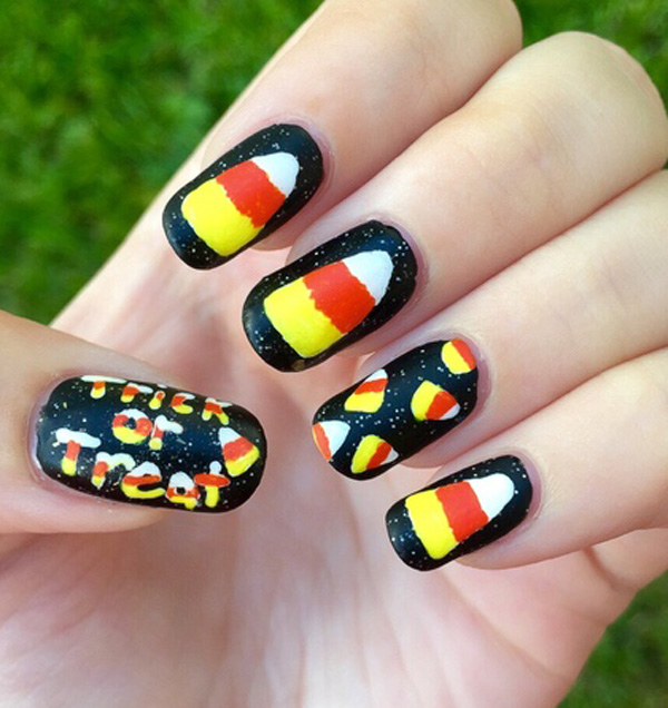 trick or treat inspired halloween nail art design coat your nails in glitter sandwich style