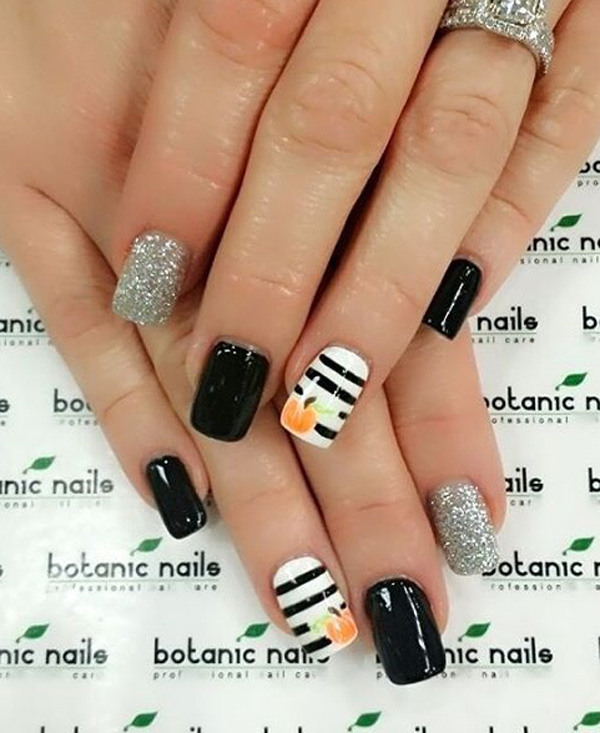 Add a touch of glamour into your spooky nails with this black and white  themed pumpkin - 65 Halloween Nail Art Ideas - Nenuno Creative