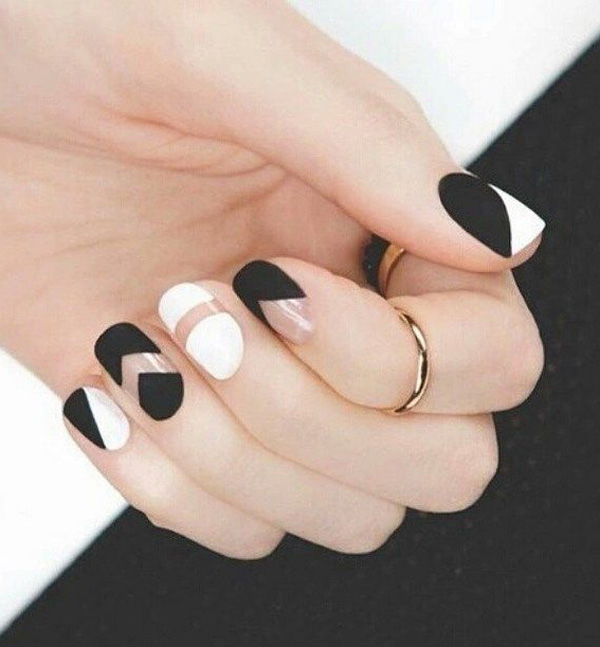 Matte black and white negative space nail art