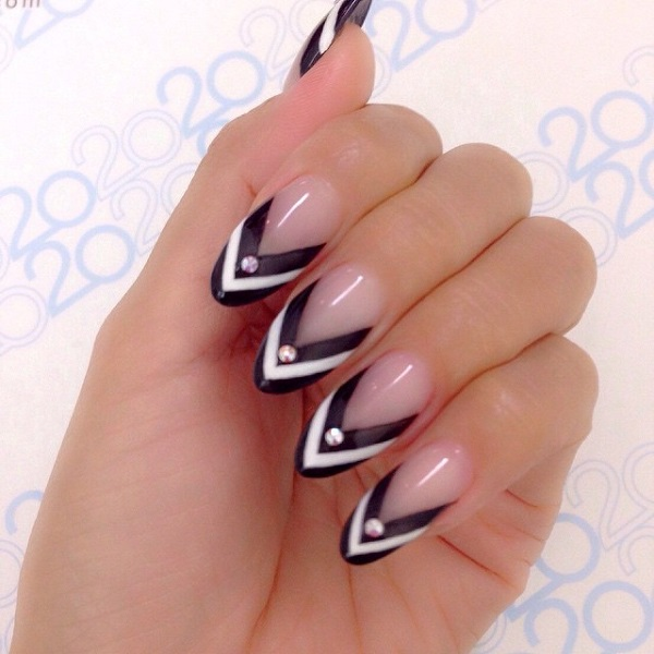 Nude almond nails with black and white Chevron tips