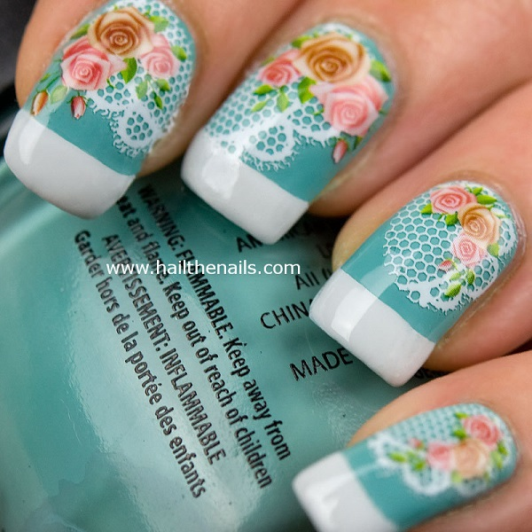 Nails with rose flower motifs on a delicate lace background