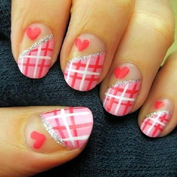 Pink nails with uneven plaid in one half and a red heart in another half