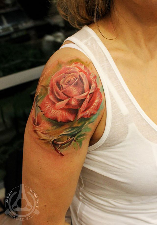 pink rose shoulder tattoo