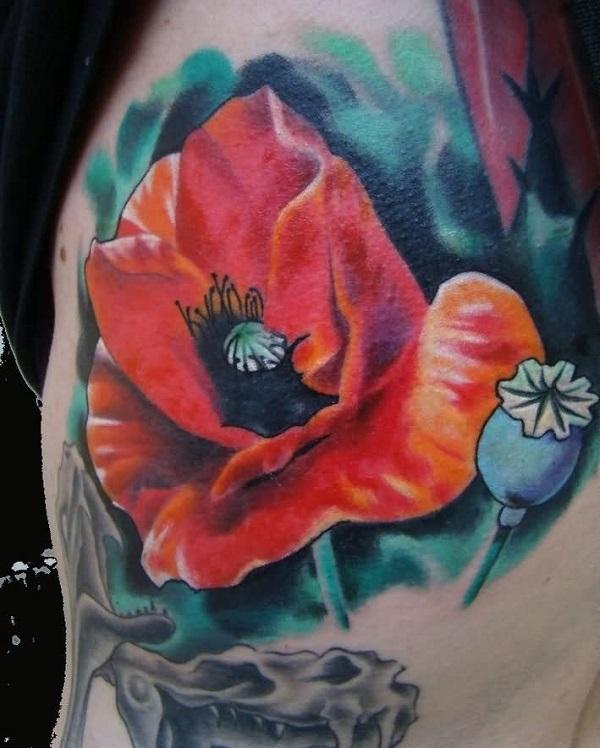 large poppy flower tattoo on shoulder