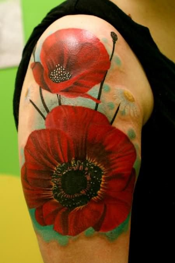 poppy flower sleeve tattoo looks floating on the arm