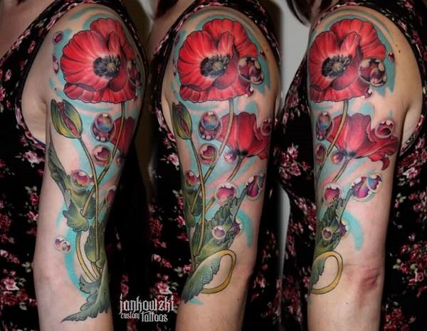 Red poppy sleeve tattoo