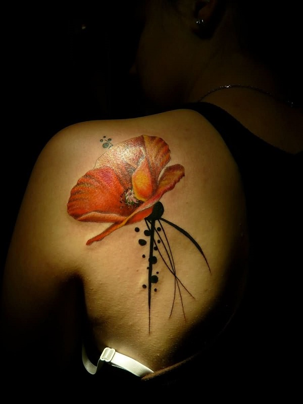 Red poppy back tattoo
