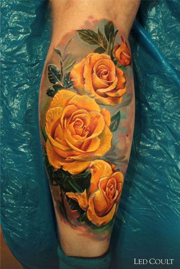 yellow roses tattoo on leg