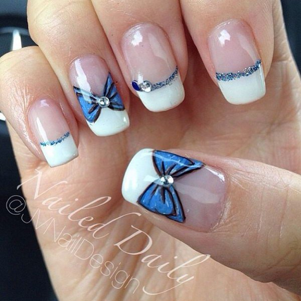 Wonderful looking blue and white French tip. Adding the bow is simply a  great idea - 55 Bow Nail Art Ideas - Nenuno Creative