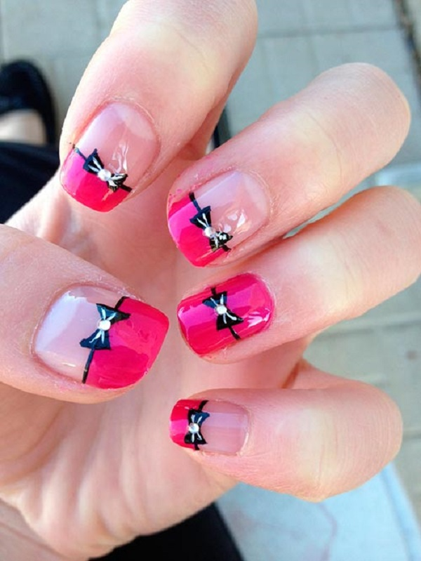 Hot pink French tips and bow nail art. Get your rhinestones ready and