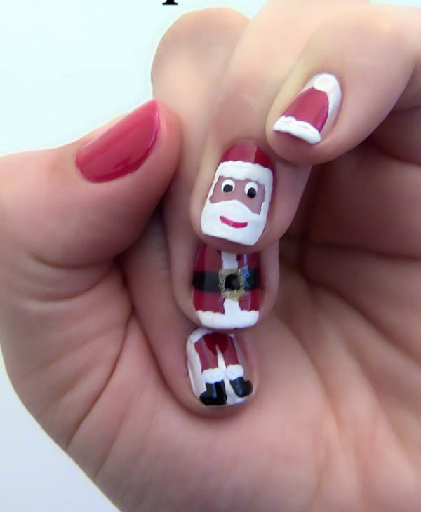 Check out this continuous Santa on the nails. This is a perfect nail art  design - 65 Christmas Nail Art Ideas - Nenuno Creative