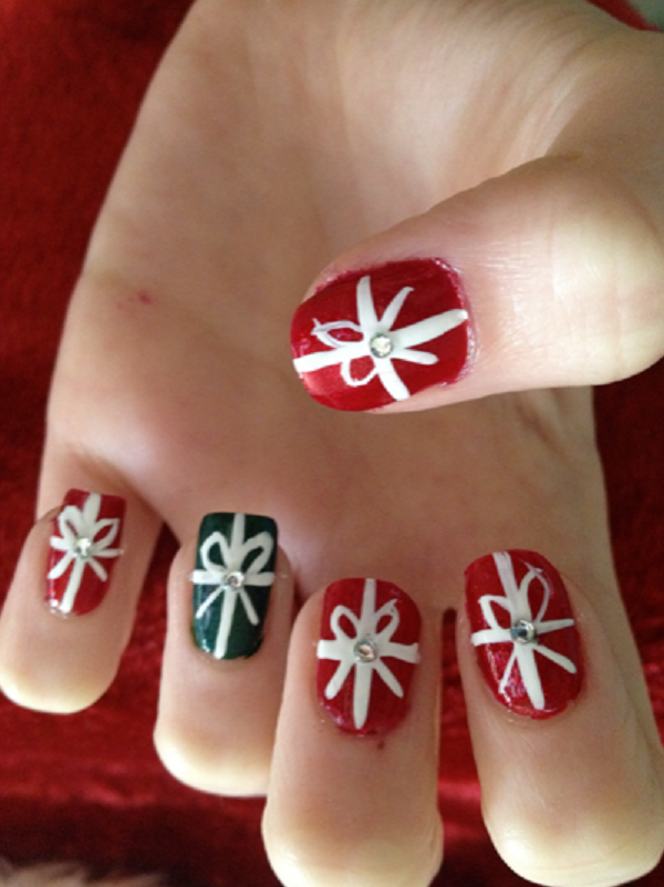 turn your nails into christmas gifts with this ribbon themed nail art design you can