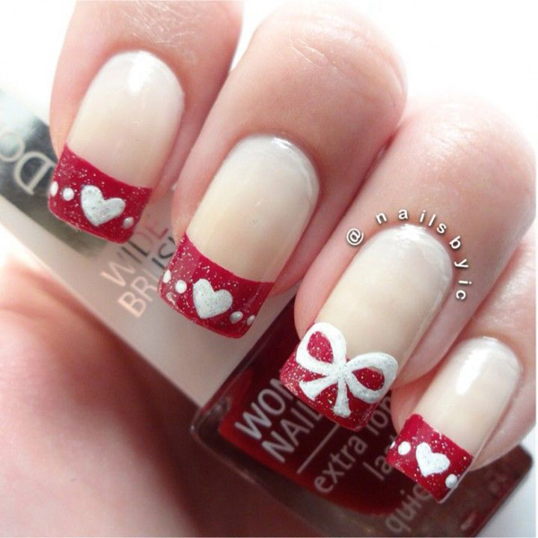 Looking for a cute Christmas French tip? This may be the design you are looking for. Use white and glitter red polish for the tips. Place accents such as glitter ribbons and hearts to give more effect to the nails.