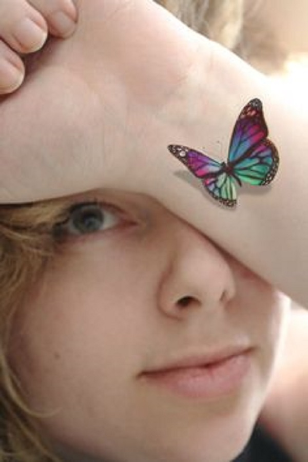 My eye and butterfly wrist tattoo