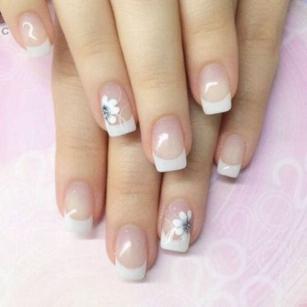 Pretty white French tips in flora design. Add a beautiful flower design on  top of - 35 French Nail Art Ideas - Nenuno Creative