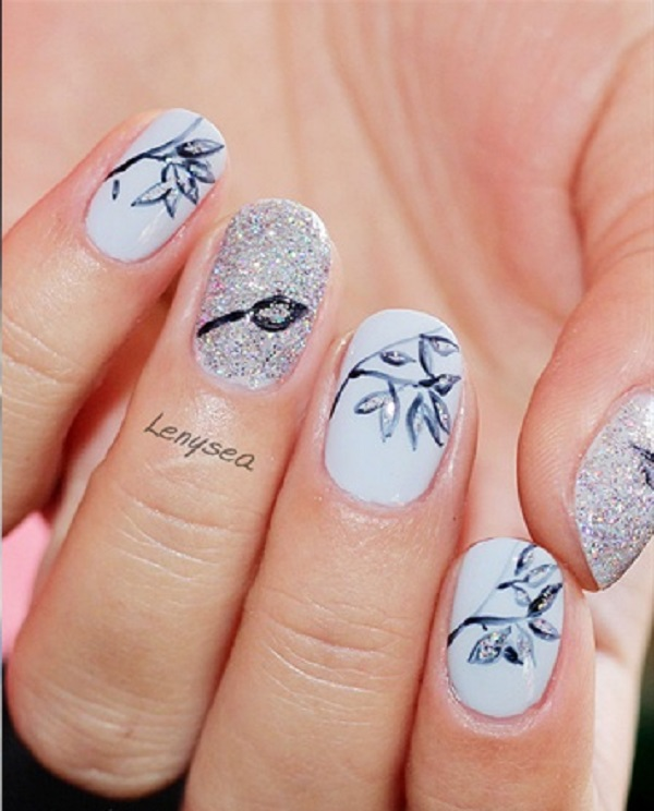 Beautiful black and white leaf nail art design. The white background  compliments the black colored - 35 Leaf Nail Art Ideas - Nenuno Creative