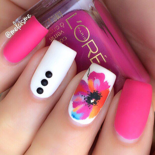 A gorgeous looking spring nail art design in pink and white polish. Create a matte effect on your nails with the pink and white polish and paint on an abstract colored on the other to stand out.