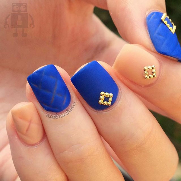 Royal blue and nude spring nail art design. Make your regular laid back color combinations stand out with help from gold beads as embellishments and a bit of style on the nails.