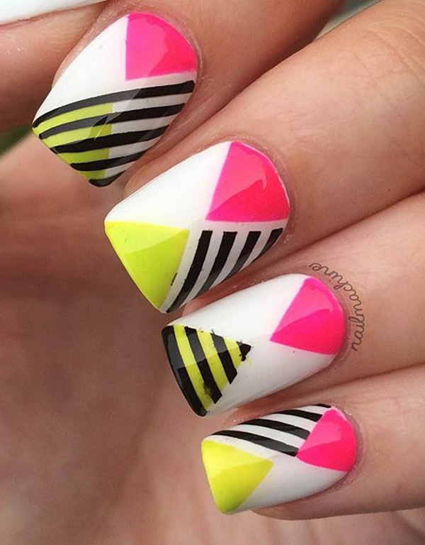 Amazing abstract themed spring nail art design. With help from vibrant colors such as yellow and pink with black and white stripes, your nails will look like they jumped out from a crazy party.