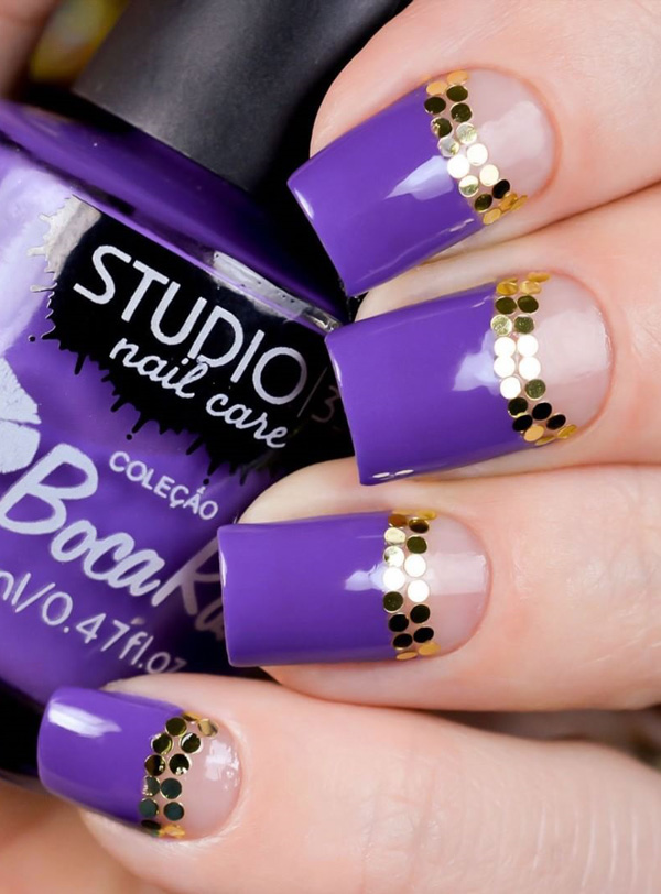 Violet inspired spring nail art design. A classy looking nail art design using violet polis painted from the tip of the nails towards a little ways from the cuticle with gold embellishments.
