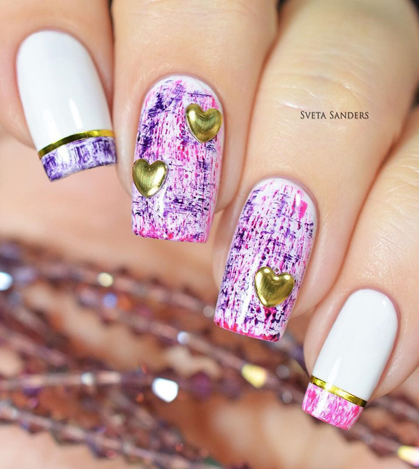 A very pretty paint splatter inspired spring nail art design. Cover your nails with white base color and let loose with the explosion of pink and purple paint splatters on top. Add gold heart shaped embellishments on to for accent.