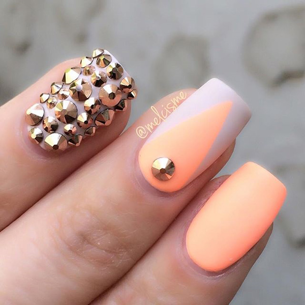 White and melon theme spring nail art design. Combine the bright melon polish with white nail polish to create that fresh look. You can even add gold stud embellishments on top for accent.