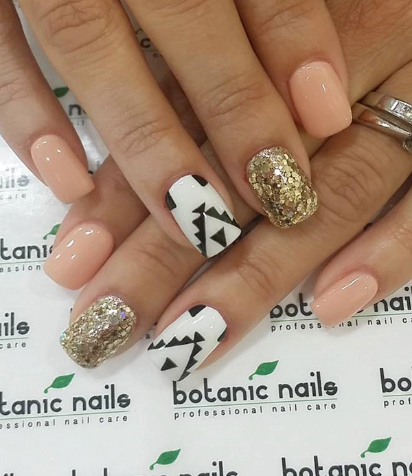 Stunning nude, gold, black and white spring nail art ensemble. Gives your nails a truly smashing look by making them uniquely designed from one nail to another.