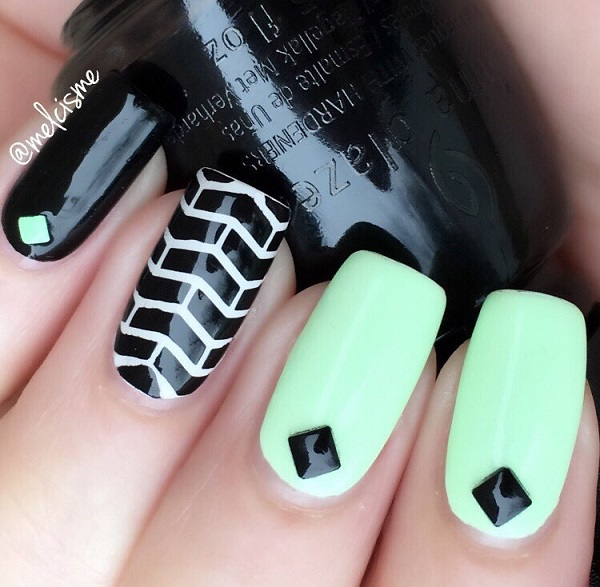 Start your spring strong with this smashing black and white nail art. Paint on black and white matte color as your base and add brick wall designs on top as well as embellishments to complete the effect.