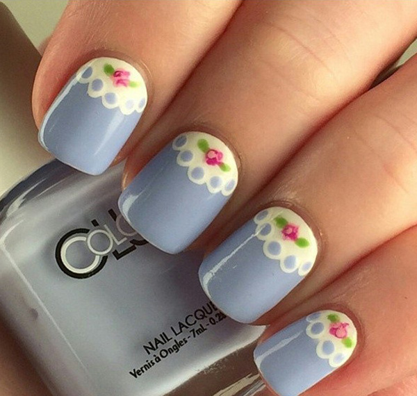 Gray blue lace inspired spring nail art design. The lace design combined with the spring theme is simply perfect. Make your nails look absolutely cute by adding pretty pink roses near the cuticle.
