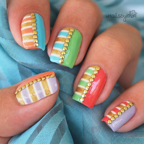Adorable pastel inspired spring nail art. Pastels are definitely the colors of spring. You can mix them up into various designs with the help of white and gold glitter polish with gold beads on top for effect.