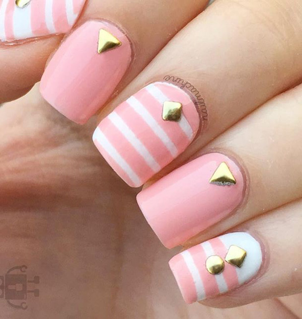 Cute baby pink and white spring nail art design. Give your nails that fresh new look as you welcome the spring. To make the light colors strand out add gold embellishments on top as accent.