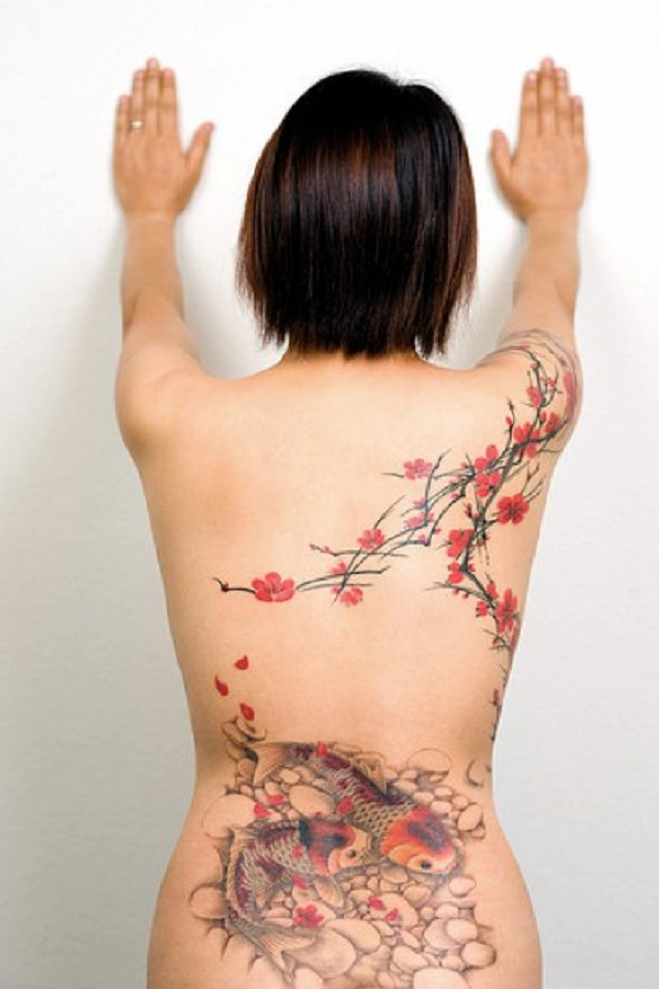 Cherry blossoms and fish tattoo on back