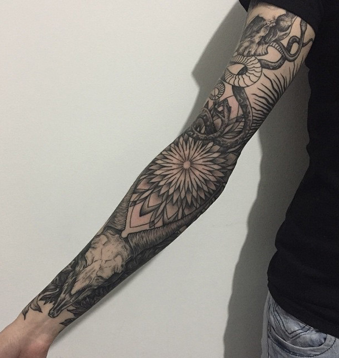092778399 Full length sleeve tattoo. This tattoo design starts from a snake that  slithers down the