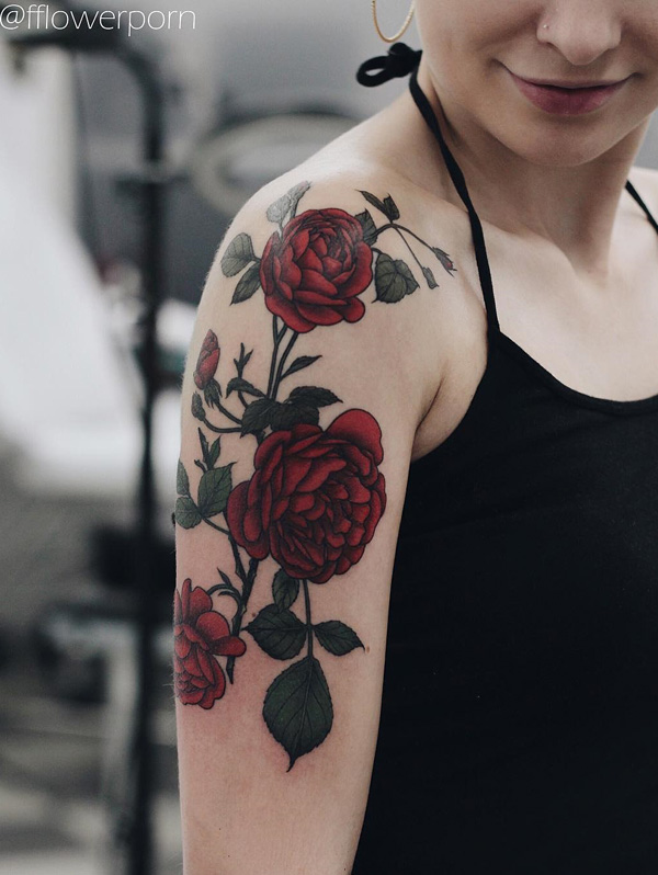Sleeve tattoo design made up of red roses. The roses are inked beautifully on the arm with dark and full colors.