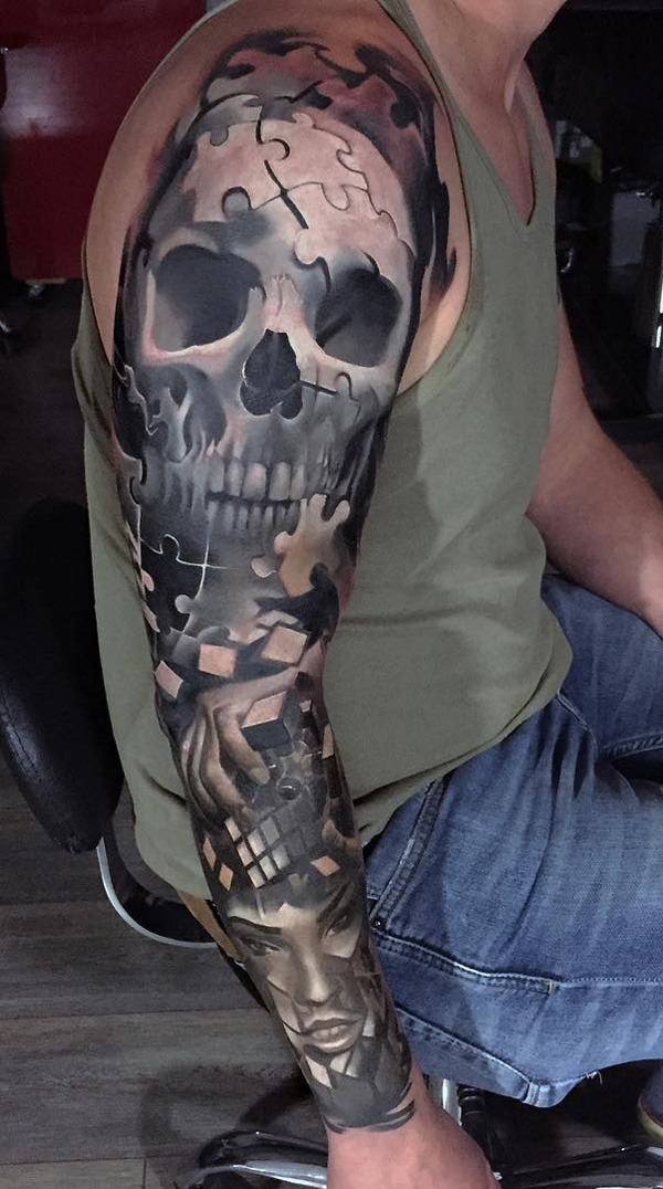 skull with puzzle sleeve tattoo-4