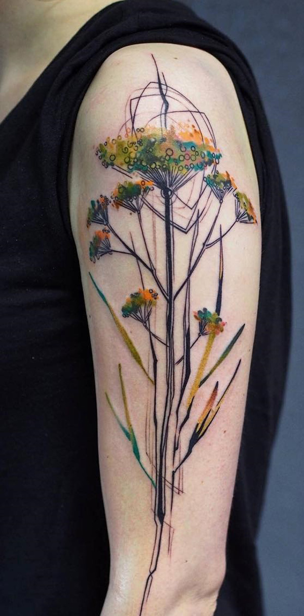 Adorable watercolor inspired sleeve tattoo. There is a botanical air to the tattoo as the flowers are blooming just about anywhere in single stems it makes you think about all the plants that you have and maybe even make you smell the roses.