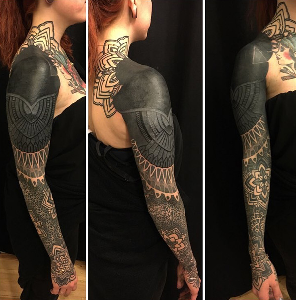 b8dfd01ac Breathtaking tribal inspired sleeve tattoo. Inked in grayscale, the sleeve  tattoo is truly stunning