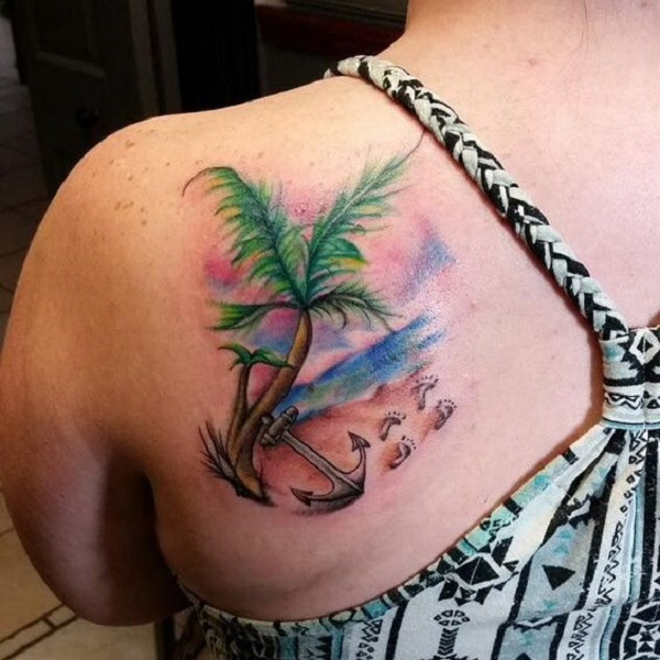ba472525e Wonderful looking beach tattoo on the shoulder. The design is small and  simple but at
