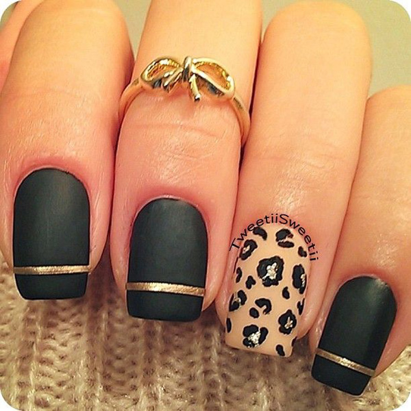Black and nude leopard nail art design. A perfect color combination when you want to go formal and glamorous. It looks classy, simple but very eye catching. The leopard prints are also very subtle but beautiful.