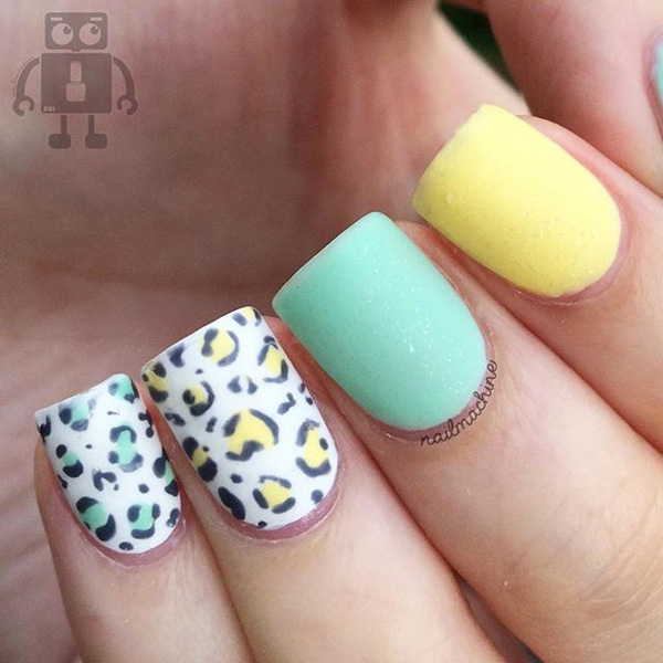 Pastel inspired leopard nail art design. The light pastel colors used in the design adds to the overall cuteness of the look. Very easy on the eyes and simple to do.