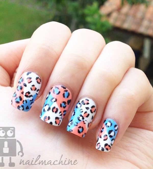 Multi colored leopard nail art design. The colorful background helps make the leopard prints more noticeable and interesting. A really simple but eye catching design.