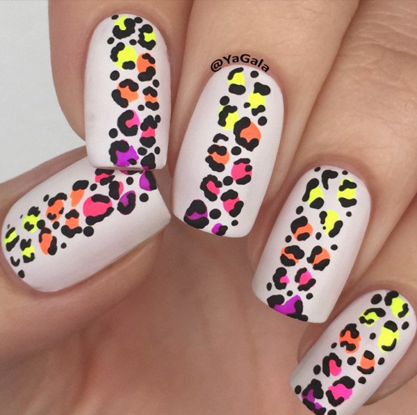 Colorful leopard nail art design. Unlike the other designs this one places the multicolored effect on the prints themselves while maintaining a pure white background.