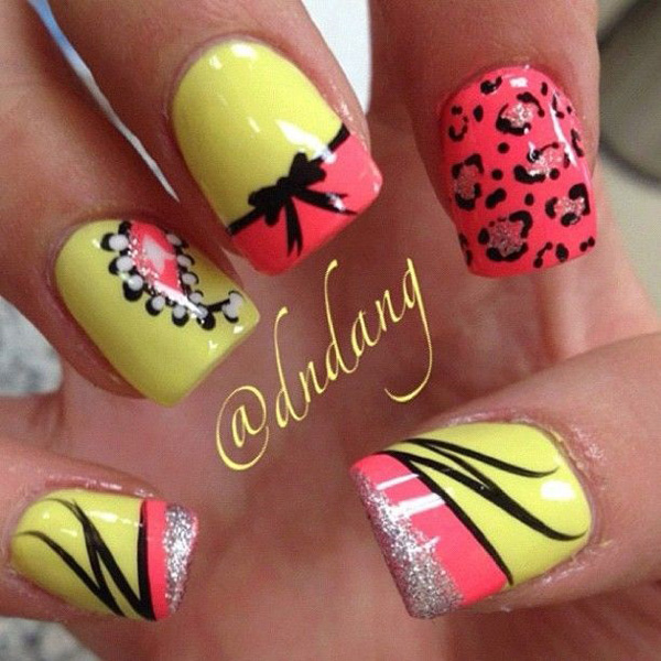 Candy colored leopard nail art design. The fun and pretty colors of this design helps make the leopard prints look adorable and cute with the addition of glitter polish and ribbons.