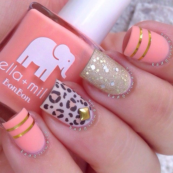 Afresh looking leopard nail art design in melon nail polish. It's a perfect combination on the melon, white and gold accents.
