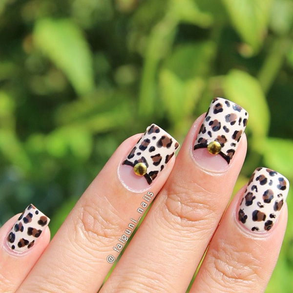 Brown and white leopard nail art design. Simple and pretty, this nail art design absolutely captivates you with how the colors are down to earth and subtle but at the same time eye catching.