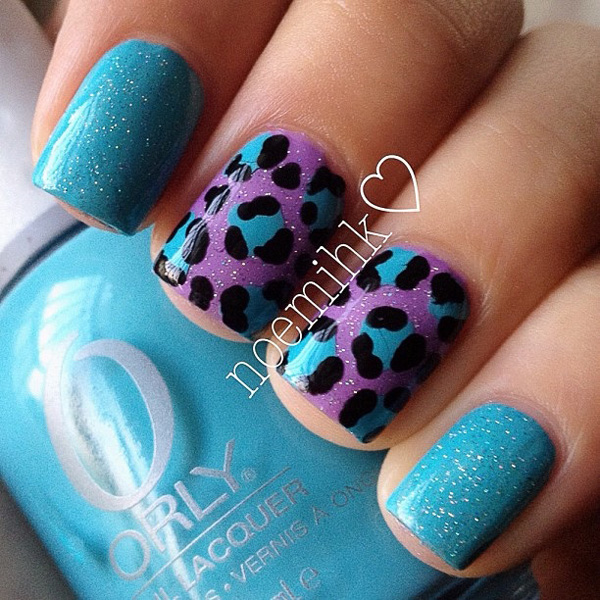 Blue and violet inspired leopard nail art design. This is one of those fresh looking designs that you would want to get for the spring or summer seasons. The frosted nail polish gives a wonderful effect to the design.
