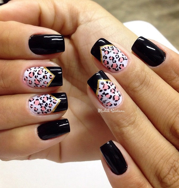 Black and white leopard nail art design with pink leopard prints. A cute and also cool looking design that also has gold metallic as lining for the French tips.