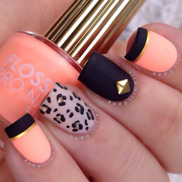 Matte inspired leopard nail art design. The background colors as well the leopard prints are painted in matte colors which make it look really classy. The added beads and metallic designs on top make it even more attractive.